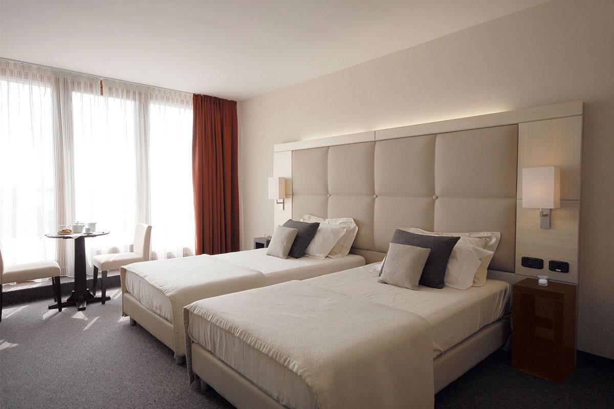 https://www.gruppo5.it/wp-content/uploads/2019/03/arredamento-camere-hotel-2.jpg