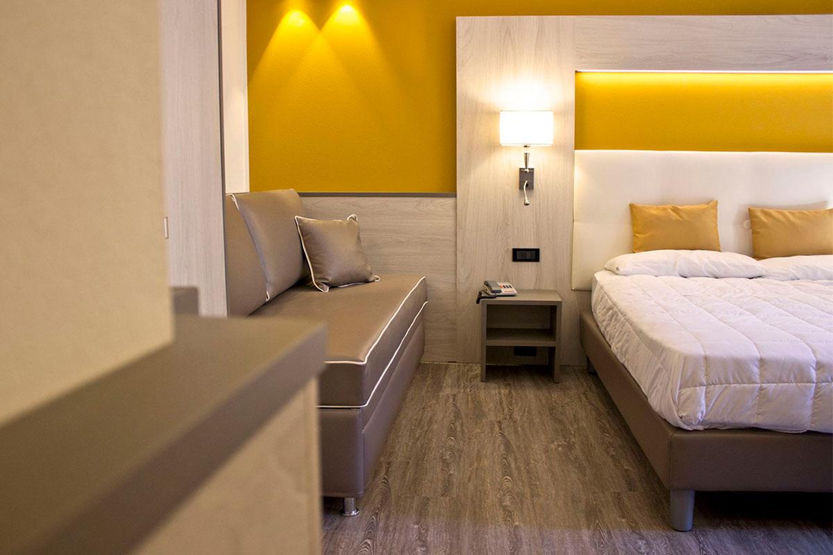 Arredo camere hotel con angolo cottura